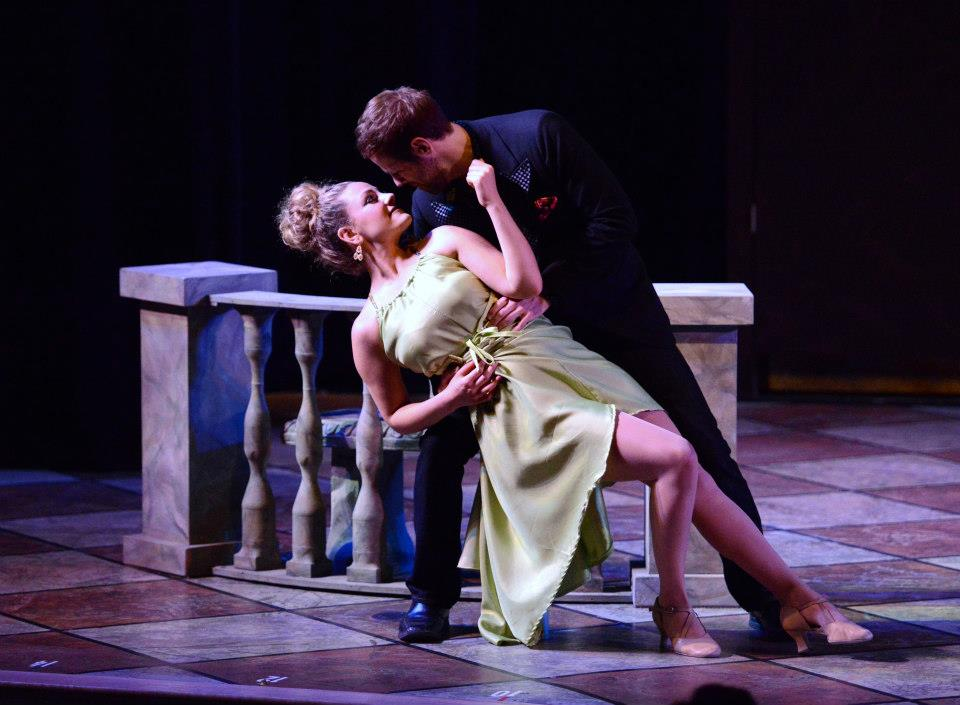 A photo of the final balustrade unit in performance.  An attractive couple is dancing on a checkered floor in front of it.